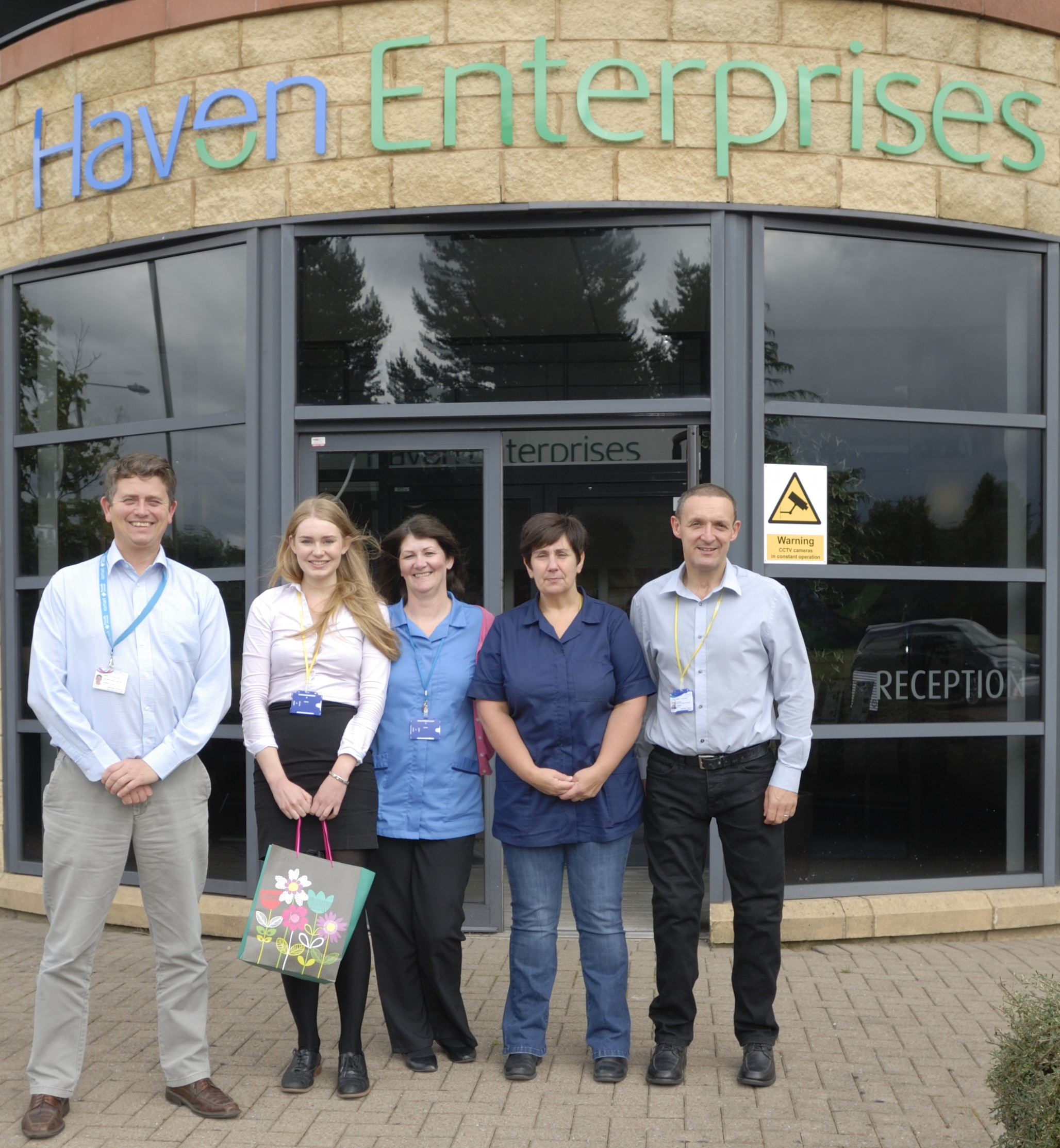 Heather and staff outside Haven PTS factory